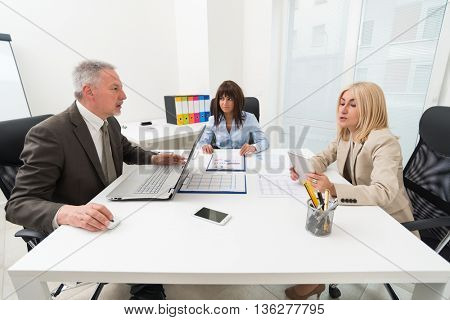 business people at work during a meeting in their office