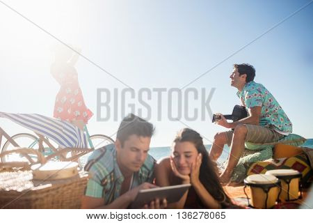 Friends enjoying together on the beach