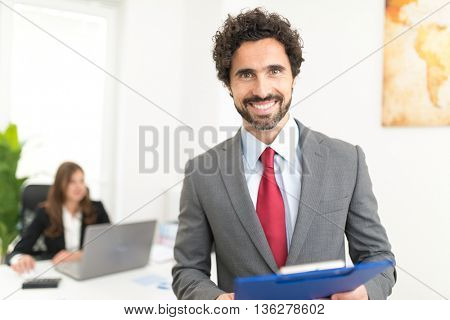 Portrait of a smiling business man in his office