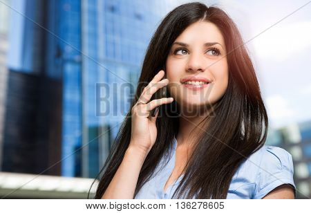 Business woman talking at the phone