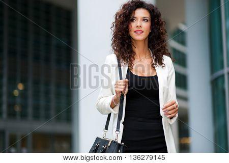 Beautiful woman walking in the city