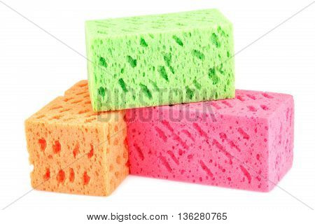Colorful sponges isolated on a white background.