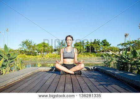 Woman sitting in yoga pose