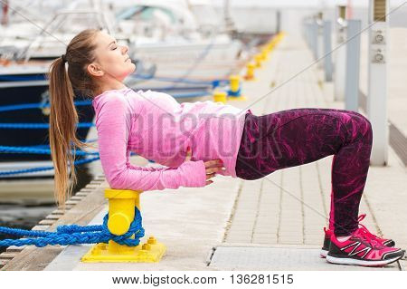 Slim Girl In Sports Wear Exercising In Seaport, Healthy Active Lifestyle