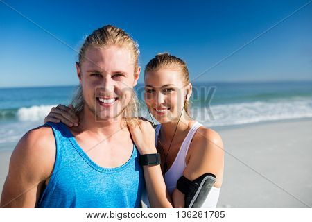 Couple standing at the beach on a sunny day