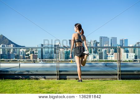 Sports woman do warming up before running