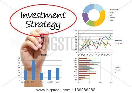 Businessman writing Investment Strategy in red circual on virtual screen. Business banking finance and investment concept.