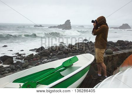 Photographer by seaside