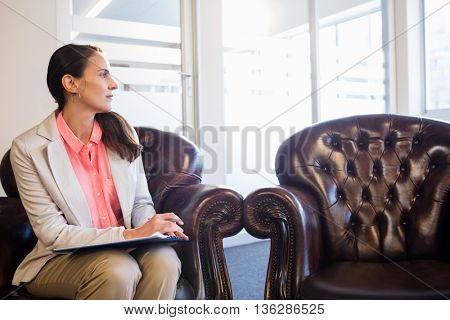Thoughtful psychologist woman in office