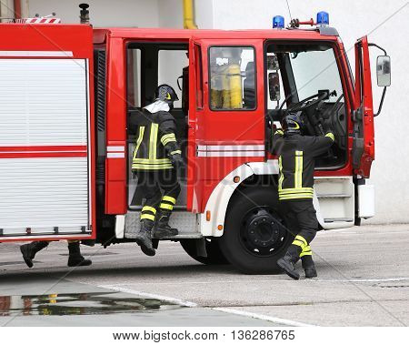 Fire Engine With Many Firefighters And Equipment For Fighting Fire