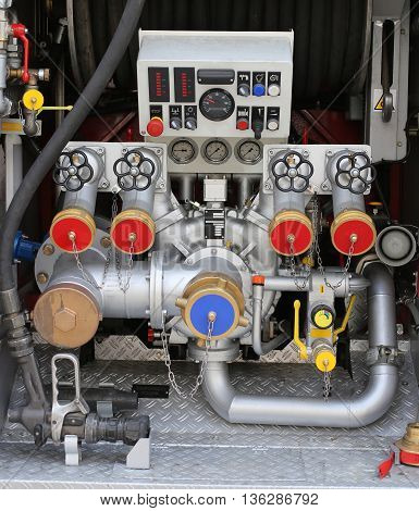 Pump Nozzles In Fire Truck With Gauges And Controls
