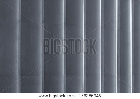 close-up texture of grey concrete wall with ridges