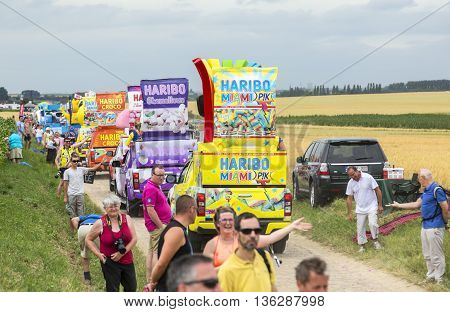 Quievy, France - July 07 2015: Haribo Caravan during the passing of the Publicity Caravan on a cobblestoned road in the stage 4 of Le Tour de France on July 7 2015 in Quievy France. Haribo is the biggest manufacturer of gummy and jelly sweets in the world