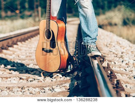 Man's legs standing on the railway image