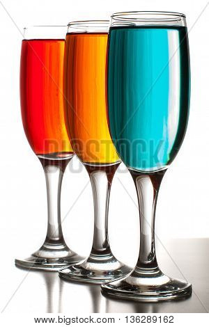 Three Beautiful Glasses Of Champagne With Colored Liquids