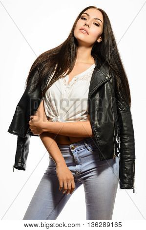 Glamorous young bautiful brunette woman in black leather jacket white T-shirt and jeans posing on a white background