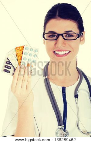 Young female doctor with pills.