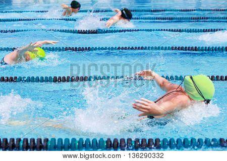 Women's Butterfly race, focus on center lane line, some motion blur