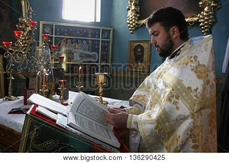 VOYUTYN UKRAINE - JANUARY 08: Orthodox priest during Christmas service in Voyutyn on January 08 2009.