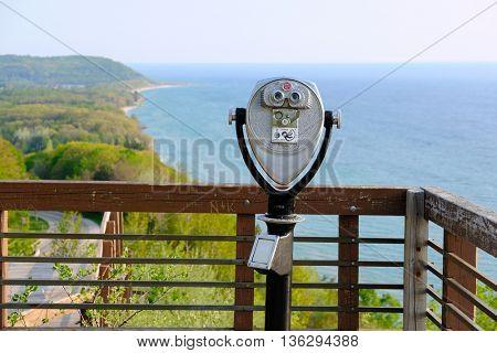 Tourist binoculars at Lake Michigan overlook near Arcadia, MI, USA
