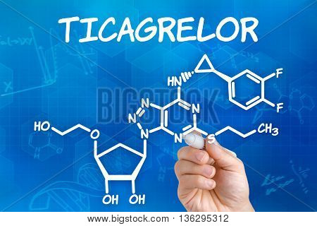 Hand With Pen Drawing The Chemical Formula Of Ticagrelor