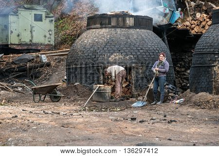 Klokocevac Serbia - March 24, 2016: The production of charcoal in a traditional manner in the forest using beech wood