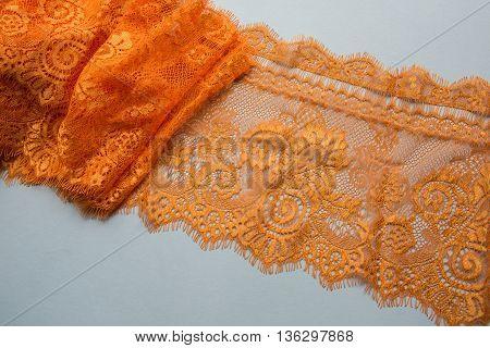 orange lace lying on a white background