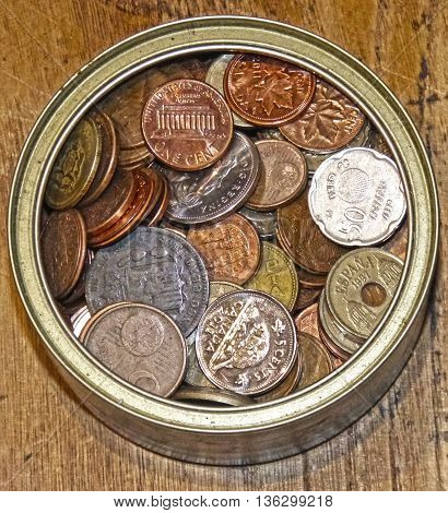 bowl of coins waiting to be spent see image