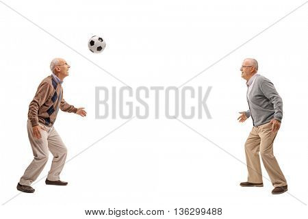 Two seniors passing a football between themselves isolated on white background