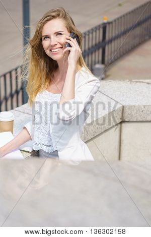 Business woman speaking cellphone on the street