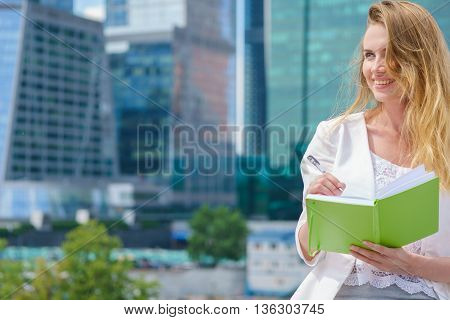 City business woman working taking notes outdoor.