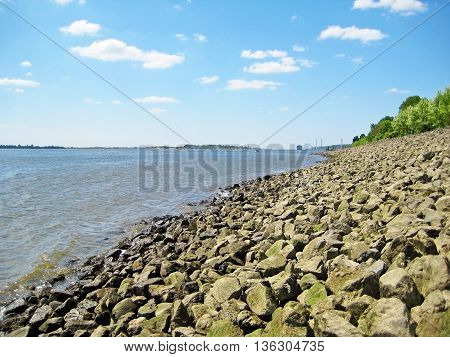 River Elbe Hamburg Germany - riverside with breakwater