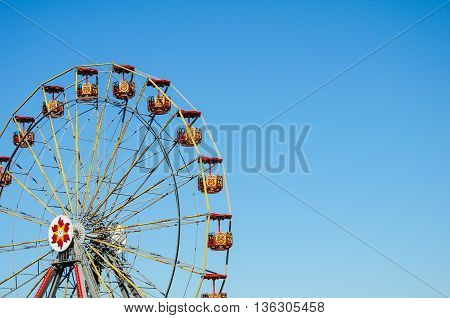 Ferris Wheel Against Bright Clear Blue Sky