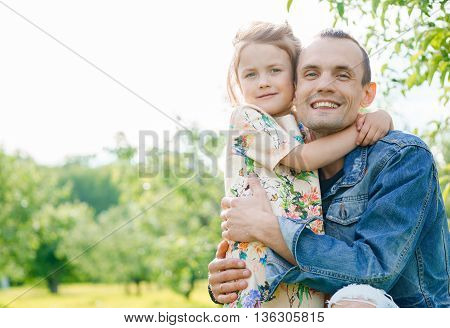 Portrait of happy family. Father with daughter outdoors