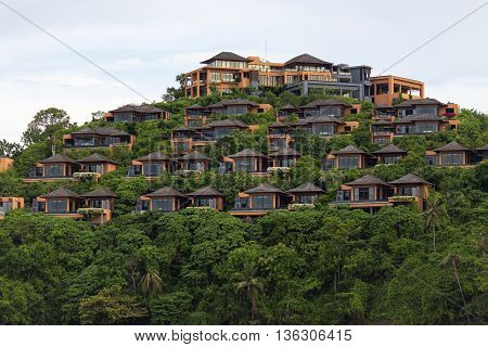 Bungalow on a hill, Hotel of several separate houses, located on different levels. Standing on the mountain near the sea in the jungle.