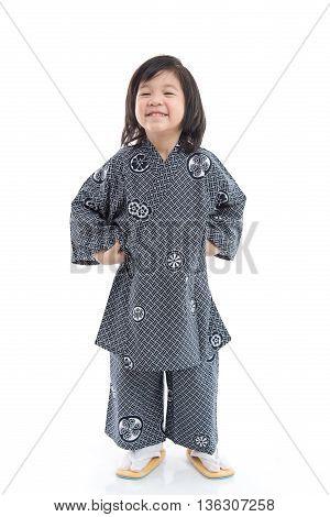 Happy asian boy in kimono sitting on white background isolated
