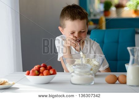 Child Mixing White Cottage Cheese In A Bowl
