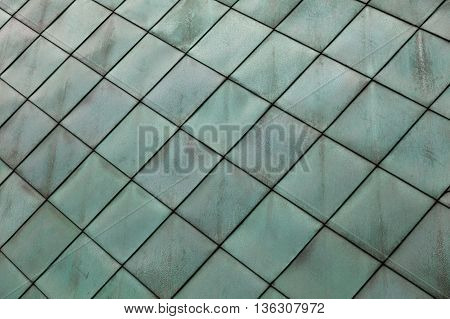 close-up texture of green facade exterior wall cladding