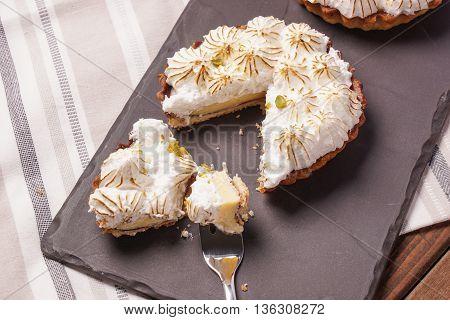 Two Lemon meringue Pie with lime zest