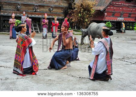 SUMATRA, INDONESIA - 22 MAY 2015 : Traditional Batak dancers performing a ceremonial dance in Bolon Simanindo Batak Museum Village in 22 May 2015