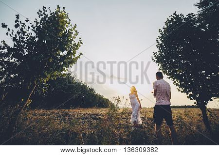 Parents and kid having fun spending time