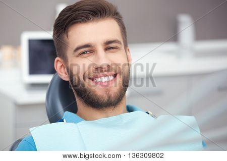Portrait Of Happy Patient In Dental Chair.