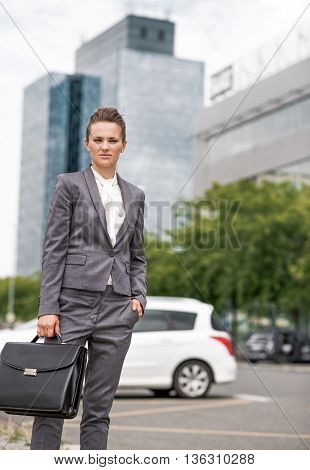 Portrait Of Business Woman With Briefcase At Office District
