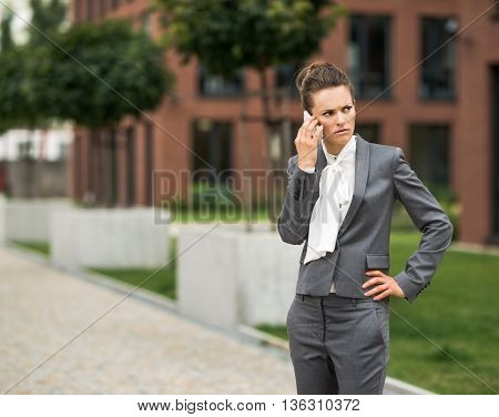 Concerned Business Woman Talking Cellphone At Office District