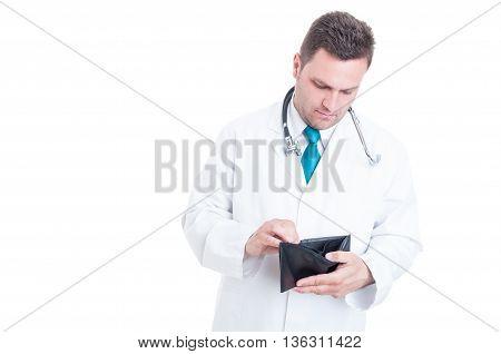 Male Medic Looking In His Empty Wallet