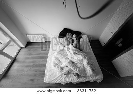 handsome man and beautiful woman on the bed