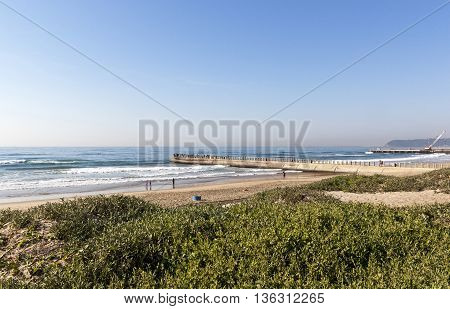 Dunes And Beach And  Concrete Pier Under Construction