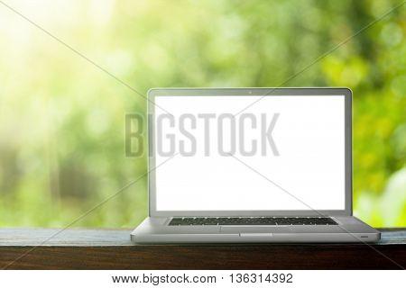 laptop on the green bokeh backrounds. Like ipade