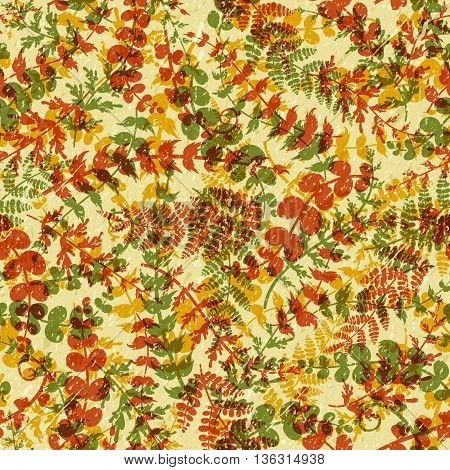 Seamless plant background. Endless autumn pattern with orange brown green twigs and leaves silhouette. Grange. Vector illustration