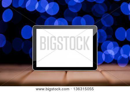 Tablet on the blue bokeh backrounds. Like ipade